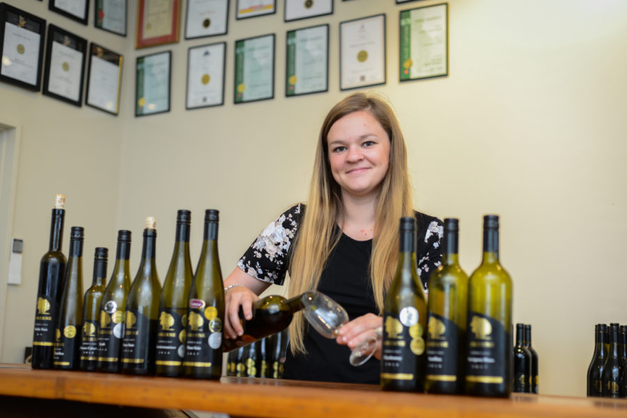 Rebecca serving award winning aromatic wine in the Askerne Winery Cellar Door Hawkes Bay New Zealand